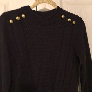 Navy blue sweater with decorative gold buttons